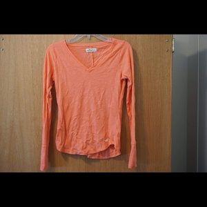 Peach colored long sleeve hollister T-shirt